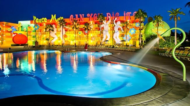 Nighttime view of the swimming pool at Disney's Pop Century Resort