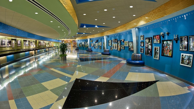Large lobby at Disney's Pop Century Resort with historical photos on the colorful walls