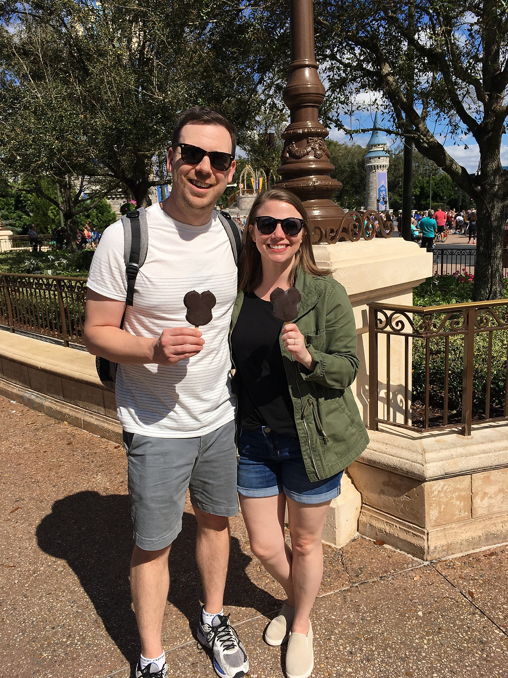 Two people eating a Mickey Ice Cream at Magic Kingdom
