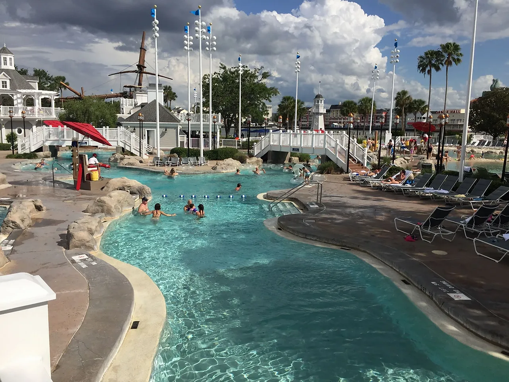 Wide view of the swimming area and lazy river at Stormalong Bay Pool at Disney's Beach Club Resort