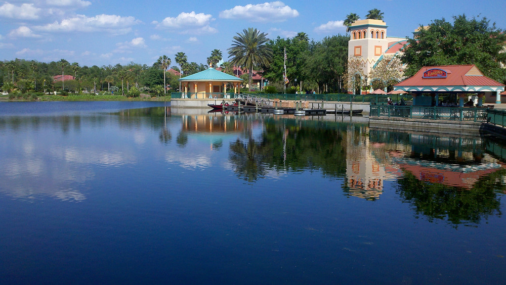 Waterfront area with boardwalk and boats at Disney's Coronado Springs Resort