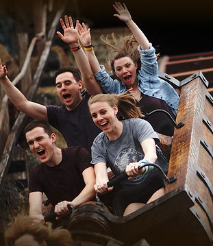 Four people riding Seven Dwarfs Mine Train at Magic Kingdom