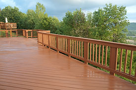 A freshly painted and stained wood deck