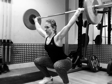 Boost your core strength with overhead squats!