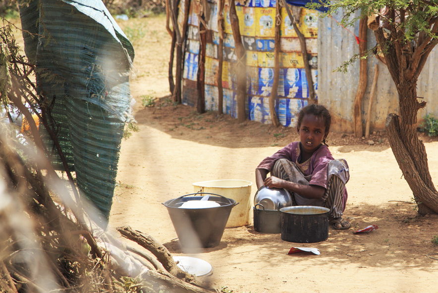 YOUNG GIRL WASHING POTS