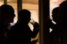 silhouettes of the groomsmen drinking beer