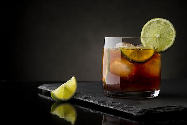 Cuba Libre cocktail with brown rum, lemo