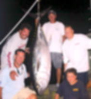 Frank and crew with a Big Eye Tuna