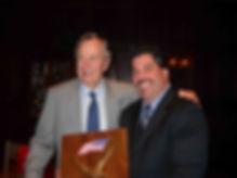 Image of President Bush awarding Capt. Frank Crescitelli