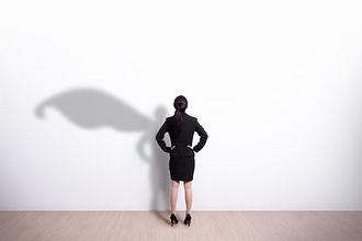 Canva - Superhero business woman looking