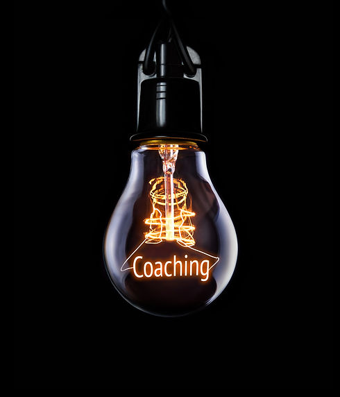 Hanging lightbulb with glowing Coaching