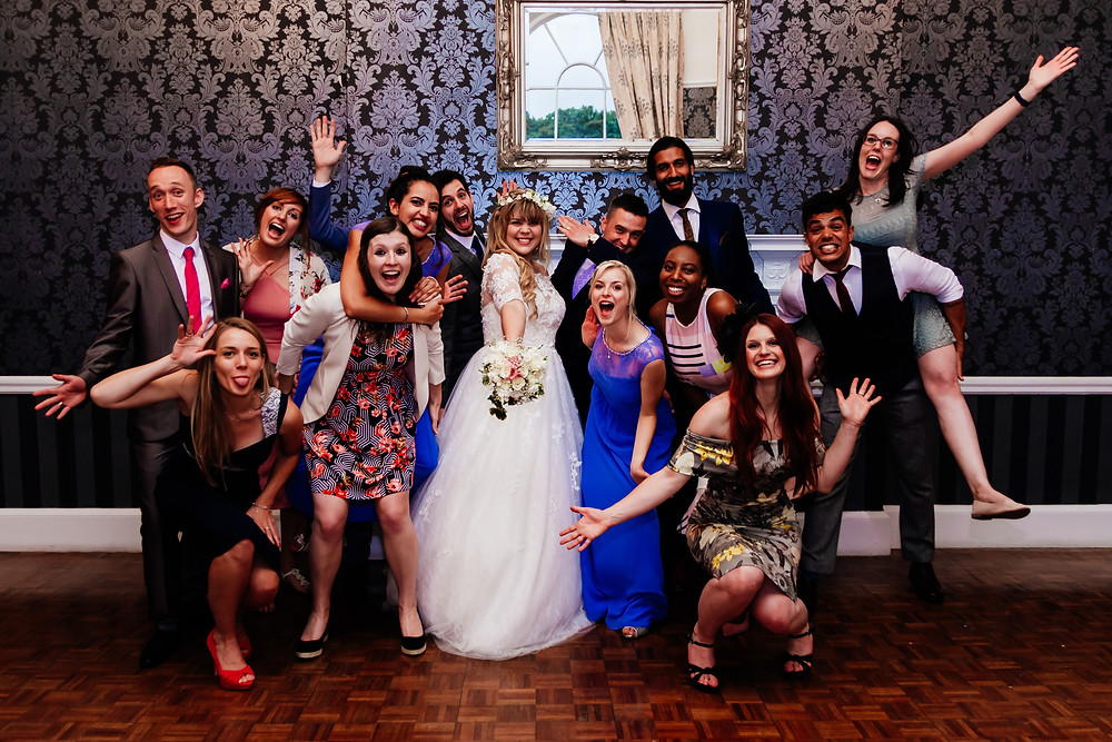 wedding, group shots, quirky group shot, fun group shot, groom, bridal party, groomsmen, bridesmaids, bride tribe, wedding guests, guests