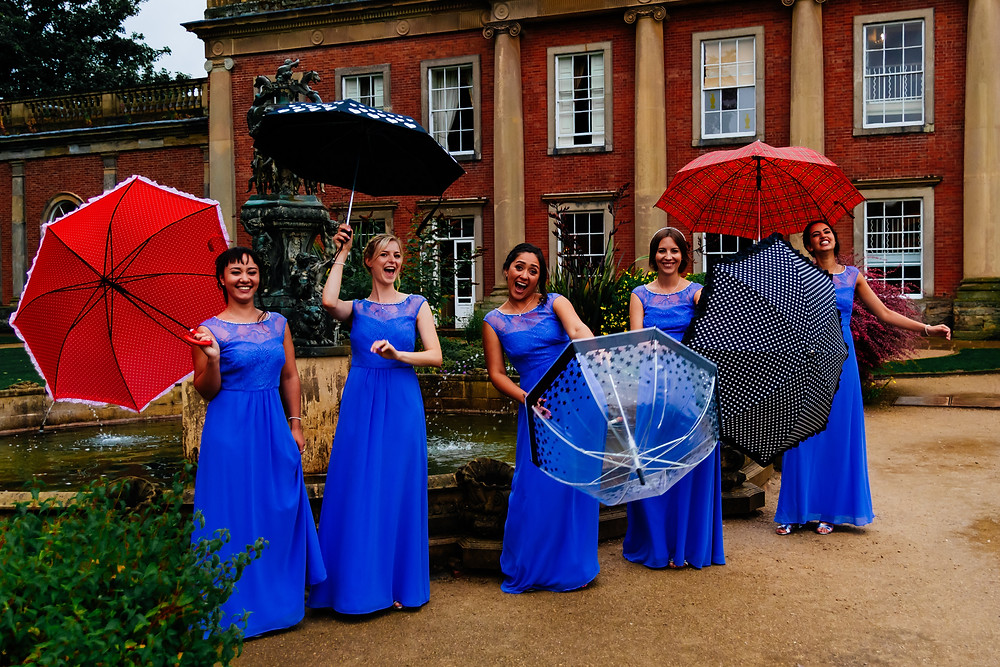 wedding, group shots, quirky group shot, fun group shot, groom, bridal party, groomsmen, bridesmaids, umbrellas, bridesmaids in blue