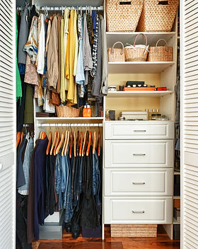 Clothes hung neatly in organized closet
