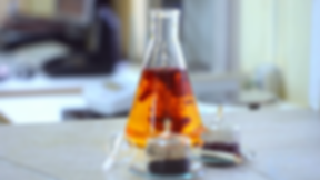 chemical-reaction-in-flask-orange-color_