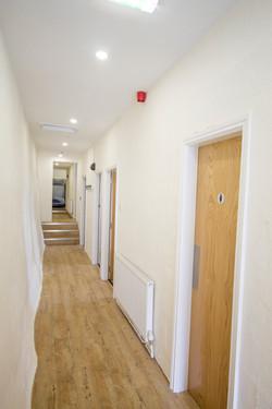 Corridor with washroom door