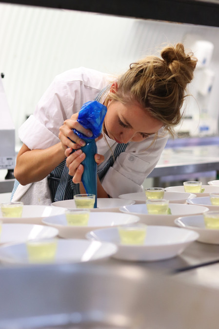 Plating at Curiouser Kitchen
