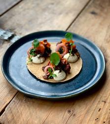 Vegan buckwheat pancakes with truffle 'cream', smoked carrot 'lox', pickled onions, massaged kale and seaweed 'caviar'