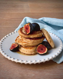 Vegan sourdough pancakes with maple syrup and figs