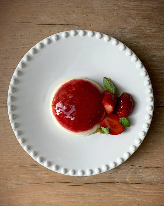 Buttermilk and fresh strawberry layered panna cotta with rosemary honey