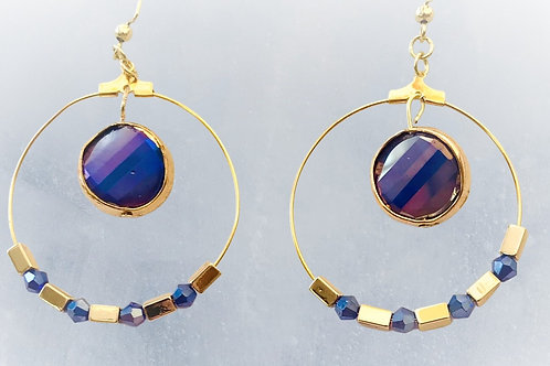 Earrings with faceted blue crystals and gold rectangles on goldplated hoops