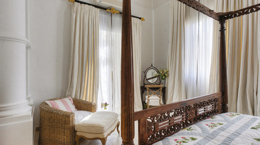 With old 'country-made' stained beech four-poster bed, which has travelled all over the world with the family! © Alan Carville