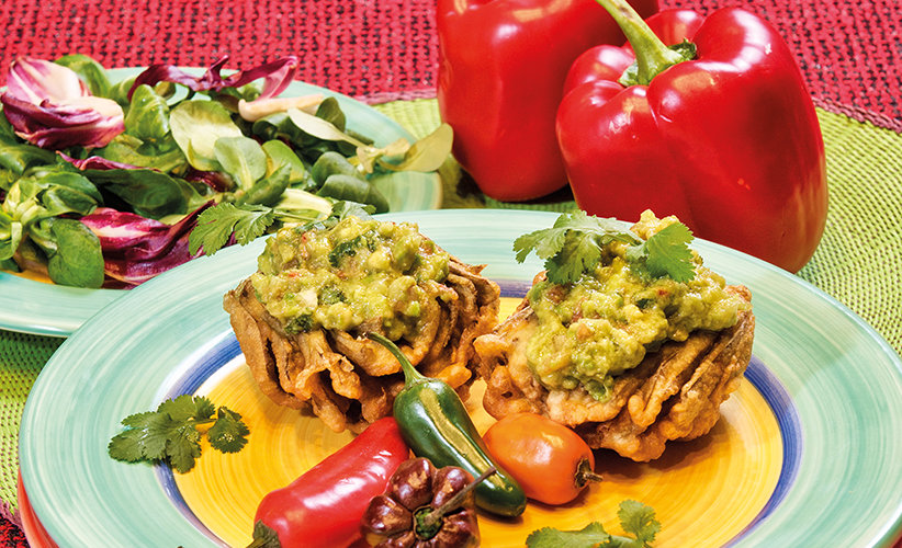 Fried artichokes in batter with guacamole sauce