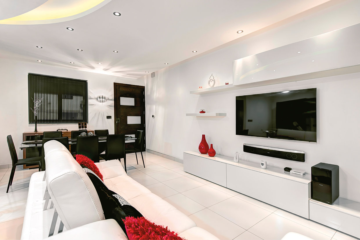 A strong accent colour against a black and white colour scheme make this an attractive living room whilst the addition of the half-moon soffit lifts it to another style dimension. © Alan Carville