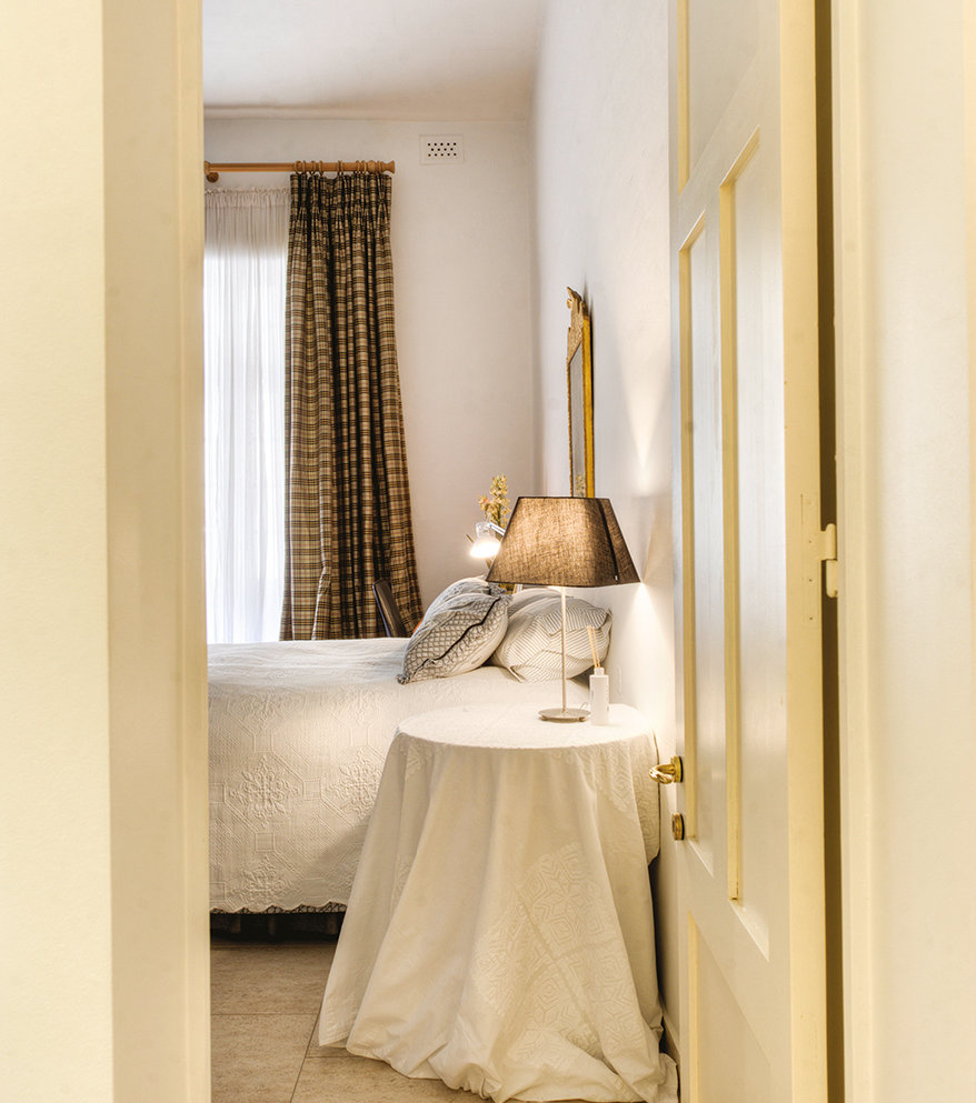 Very simply furnished in greys and browns, looking towards its ensuite bathroom. © Alan Carville