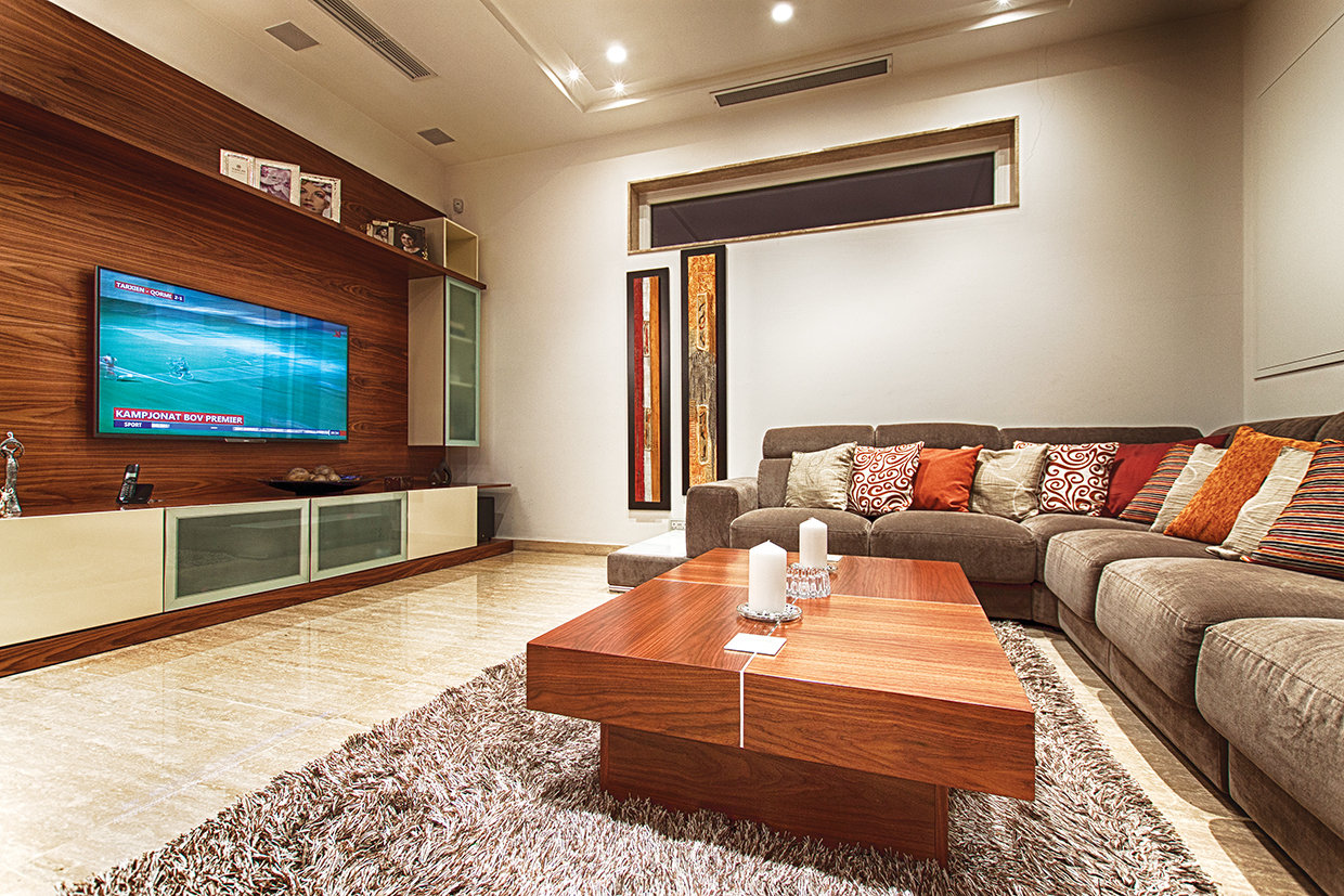 The living area beckons with its large and comfortable corner sofa.