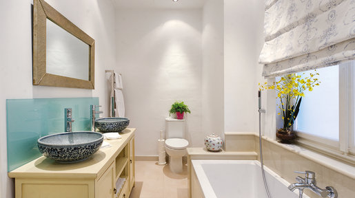 Modern Chinese painted sideboard was adapted to take the blue 'crackle-glaze' basins. There is a large walk-in shower. © Alan Carville