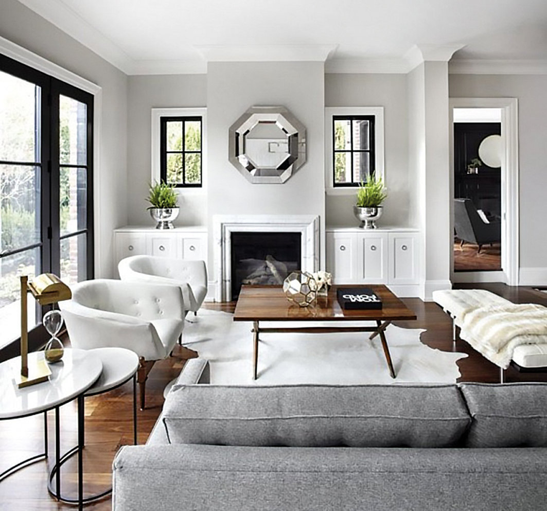 The softness of the sofa, rug and seat blanket brings in a welcome feeling to the sitting area.