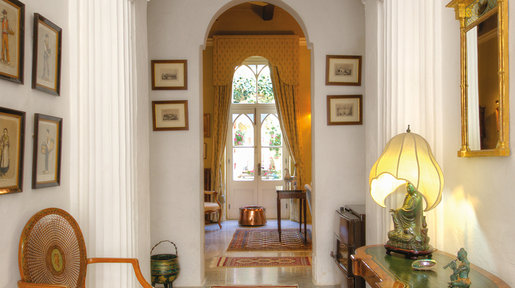 The Entrance Hall with pillars and an arched ceiling is both attractive and welcoming and leads one through to the rear of the house and the garden. © Alan Carville