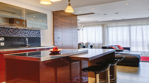 The bold use of Burgundy in the Fino kitchen is a stand out feature in this apartment. © Alan Carville