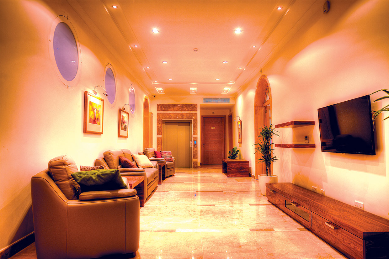Although the lobbies serve two different units there is cohesion of style in the colour scheme and extensive use of marble.