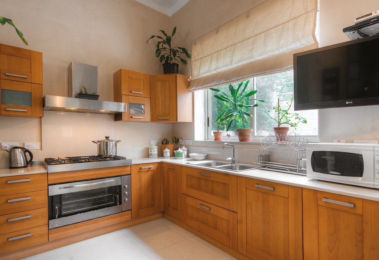 The kitchen is a modern affair with the added bonus of a breakfast nook which takes the place of a pantry. © Alan Carville