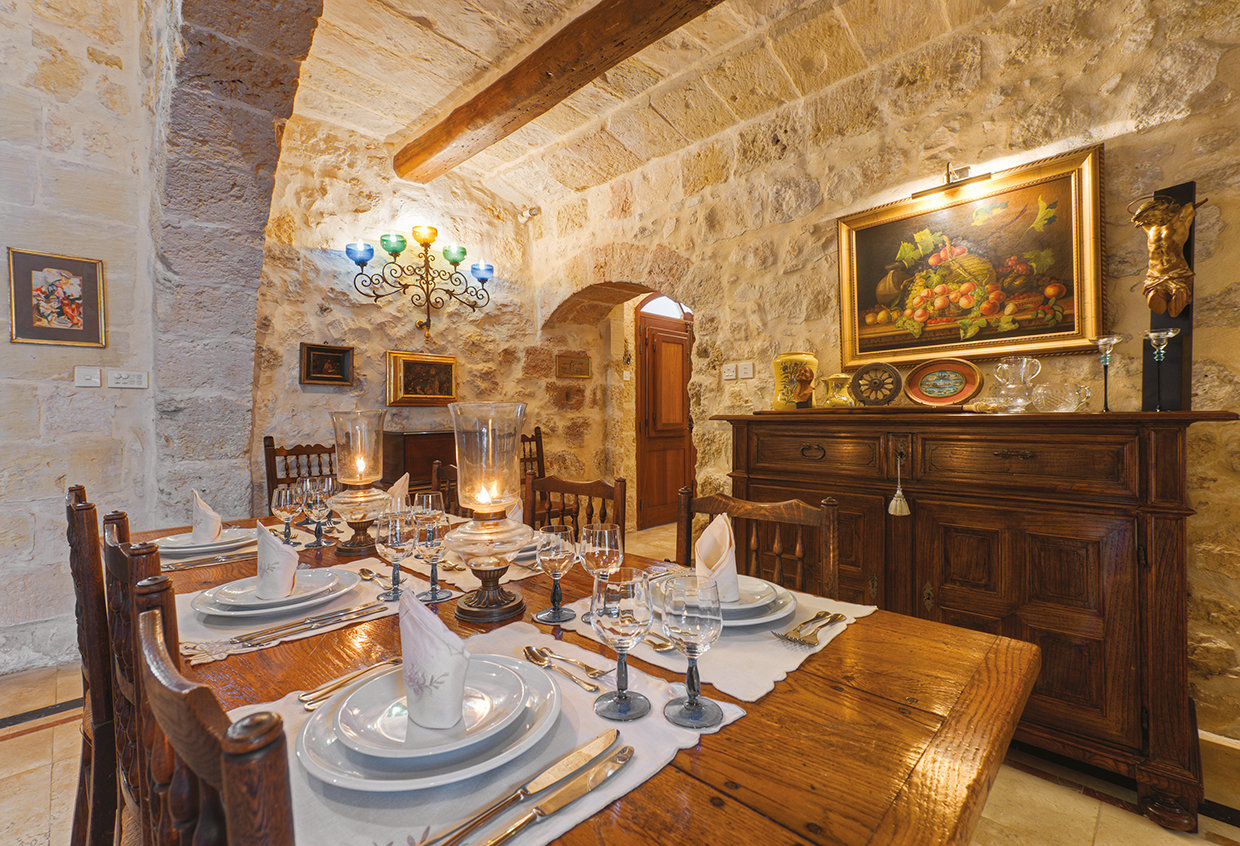 The dining room is also home to some fine antiques including a Maltese walnut armoire from the 17th century. © Alan Carville