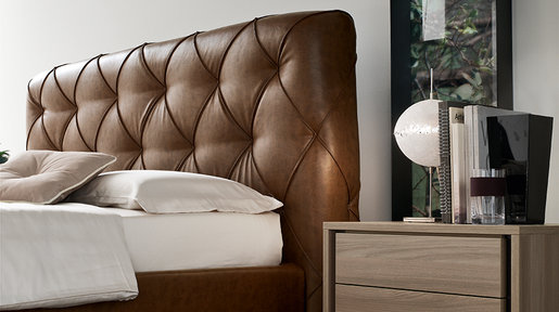 The faux leather upholstered headboard creates an imposing, decorative bed. This classic piece features neat lines and sophisticated details that ooze elegance in every sense of the word.