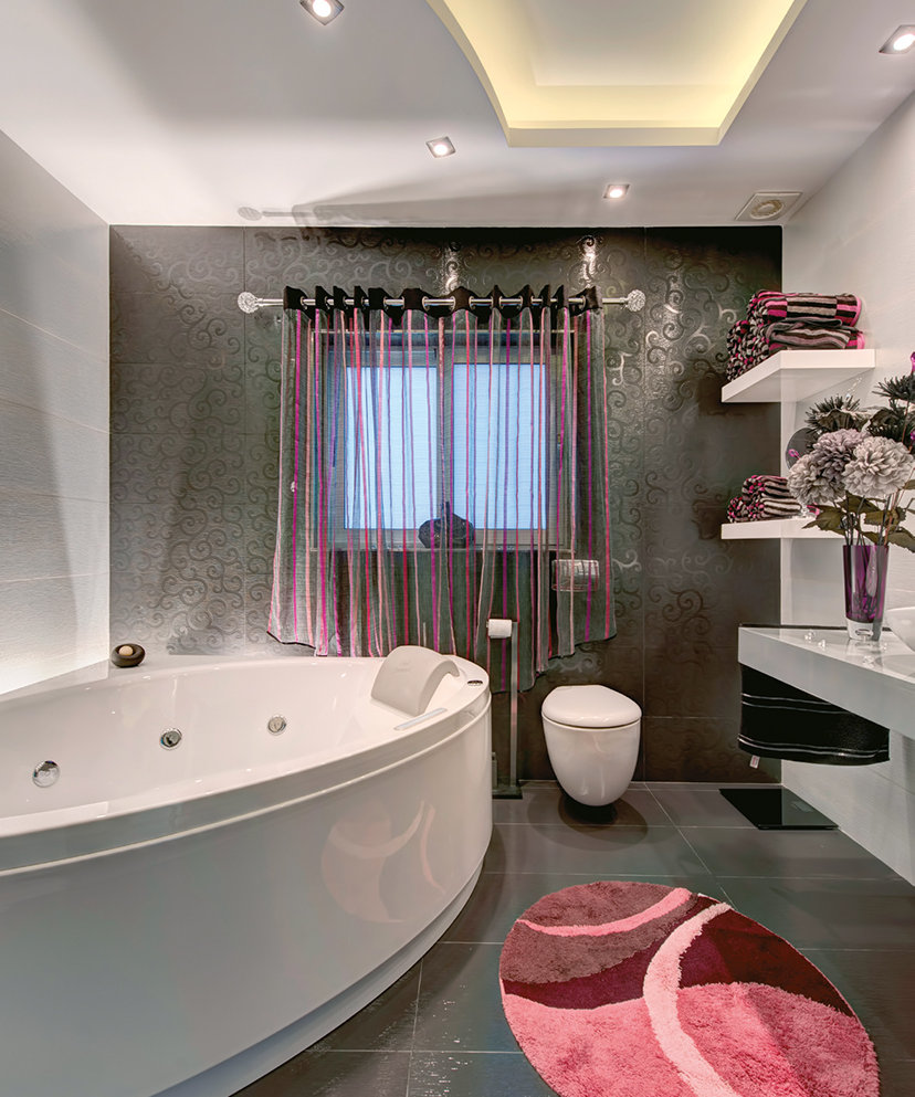 This understated monochromatic style bathroom is brought to life by dramatic flashes of fuchsia and colourful accessorizing that bring a distinctly youthful feel to a classic style. © Alan Carville