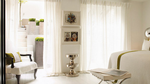Even an all white space can be softened with the use of fabrics and texture.