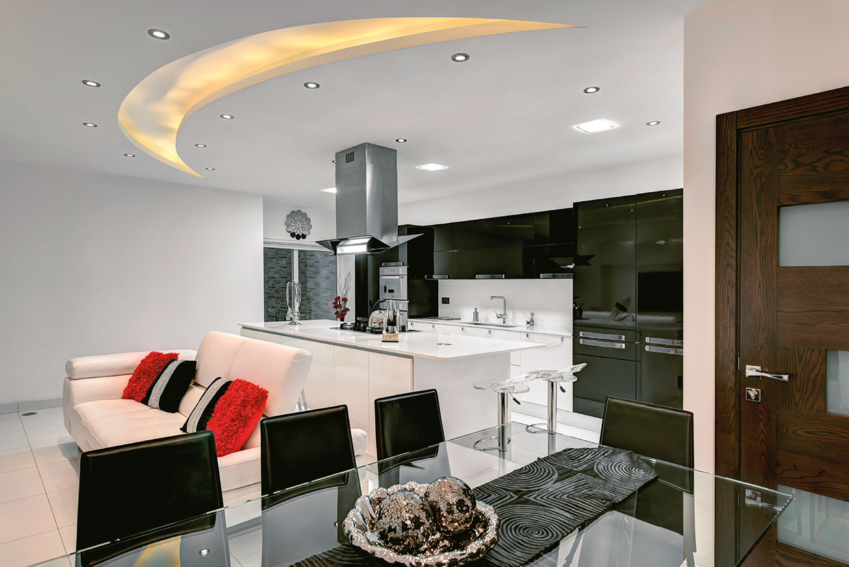 Despite the challenges it posed this modern kitchen works well within the context of the open plan living space whilst retaining its own self of individuality as a separate area. © Alan Carville