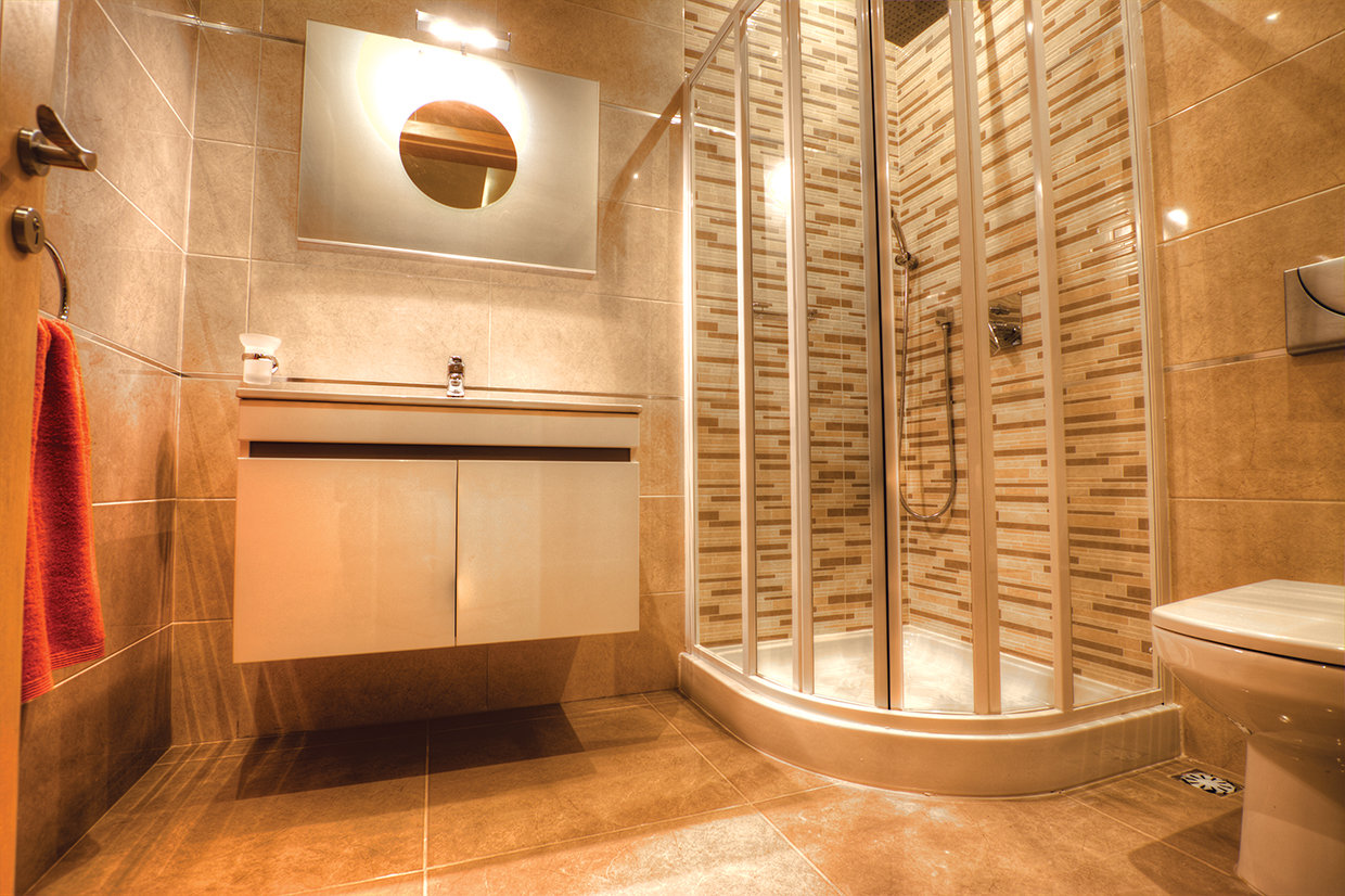 A plain tile in two tonalities and combined in a variety of ways means that every bathroom in this facility is actually unique which is a style achievement in itself!
