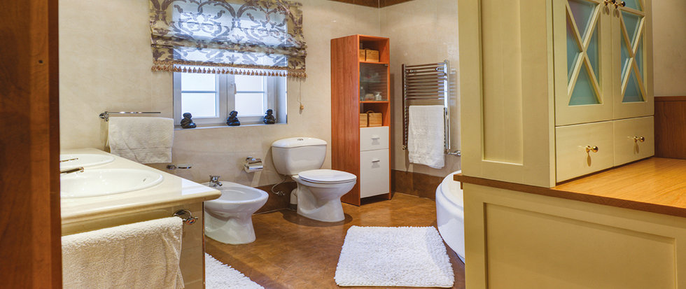 The bathroom is large and attractively designed with twin sinks and a large corner bath. © Alan Carville
