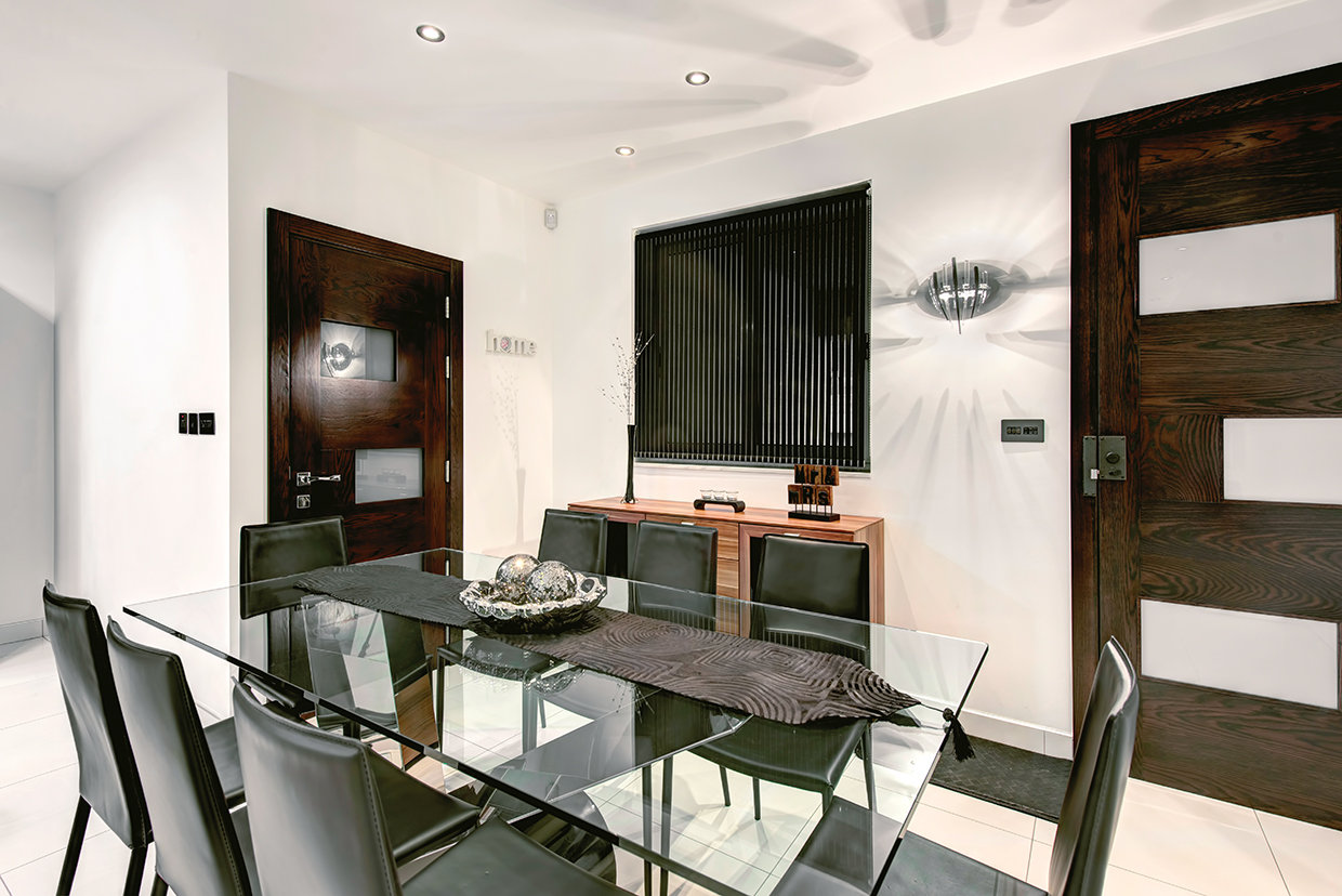 Located between two doors it's a case of access all areas for this dining room that is located immediately adjacent to the living room and continues the continuity of style that permeates throughout this apartment. © Alan Carville