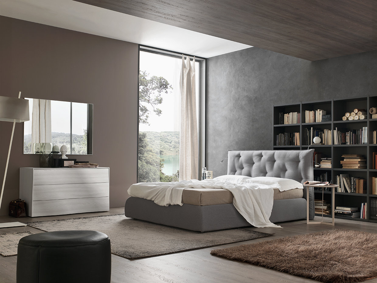The unusual upholstery adds decoration to the headboard and creates an elegant ambiance in the bedroom. Sinuous lines meet soft nubuck to create a really relaxing space.