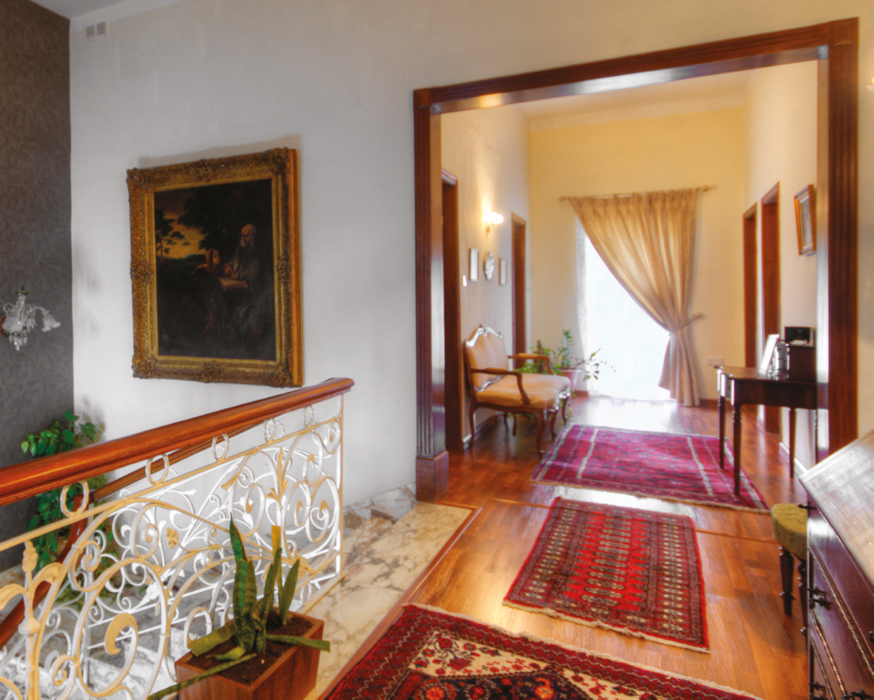 The hall upstairs is roomy with space for another living area. © Alan Carville