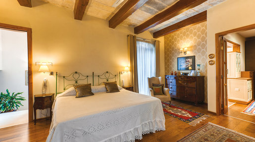 The master bedroom is elegantly designed with some fine antiques and artwork. © Alan Carville