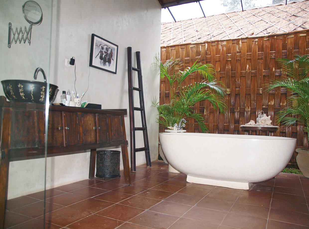 A rustic style bathroom that looks out onto the garden whilst offering complete privacy! © Nikita Arnett