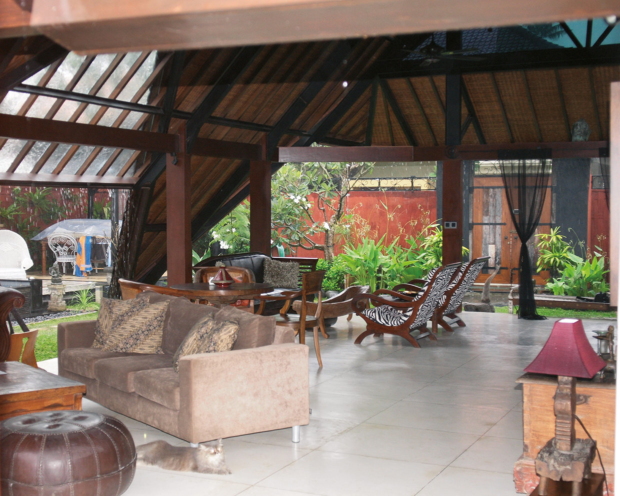 Beamed ceilings lined with rattan create the ultimate insulation. The height and wide open spaces allow for air flow and eliminate the need for conventional air conditioning. The house was designed and furnished to be environmentally friendly and has a mixture of Balinese and Japanese furniture in keeping with ecological and Feng Shui principles. © Nikita Arnett