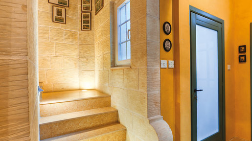 The stairs to the first floor are newly constructed and work seamlessly with the original part of the farmhouse. © Alan Carville